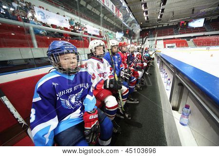 MOSCOW - APR 28: Young players watching on closing ceremony of championship season of 2011-2012 Ice Hockey for Sports School, junior teams on April 28, 2012  in Sokolniki, Moscow, Russia.