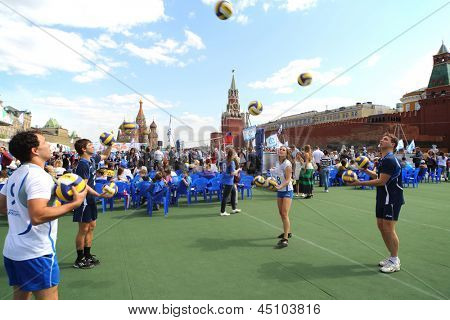 MOSCOW - MAY 26: Volleyball players warm up on VIII Forum Ready for Labor and Defense on May 26, 2012 in Red Square, Moscow, Russia.