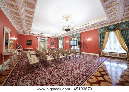 MOSCOW - APR 24: Luxury Red Hall in Guest extension for meeting with newspersons in Grand Kremlin Palace, Apr 24, 2012, Moscow Russia. Grand Kremlin Palace is ceremonial residence of Russian President
