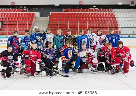 MOSCOW - APR 28: Different teams took off helmet for general photography, closing ceremony of championship season of 2011-2012 Ice Hockey for Sports School, junior teams, Apr 28, 2012, Moscow, Russia.