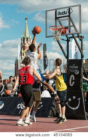 MOSCOW - MAY 26: Basketball player throws the ball in the basket on VIII Forum Ready for Labor and Defense on May 26, 2012 in Red Square, Moscow, Russia.