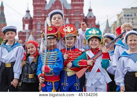 MOSCOW - MAY 27: Children dressed in costumes on Red Square during 8-th sports forum GTO, May 27, 2012, Moscow, Russia. More than 50 teams perform their sports program in forum.