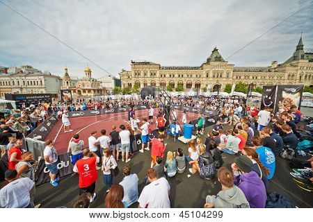 MOSCOW - MAY 27: People watch basketball game during Dudu Streetbasket fest on Red Square, May 27, 2012, Moscow, Russia. Streetbasket fest takes place within 8th sports forum GTO.
