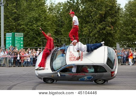 MOSCOW - JUN 30: Seven members from stuntmen team Avtorodeo Togliatti Trick go by car on two wheels at Speedfest at Olympic complex Luzhniki , June 30, 2012, Moscow, Russia.