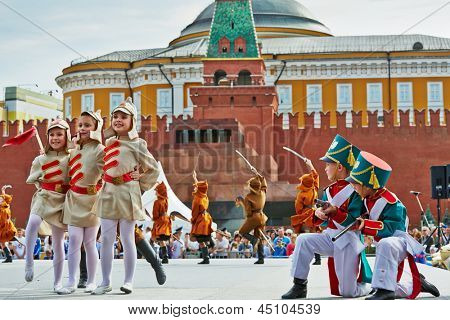 MOSCOW - MAY 27: Children pop-group Multicase concert performance on Red Square during 8-th sports forum GTO, May 27, 2012, Moscow, Russia.