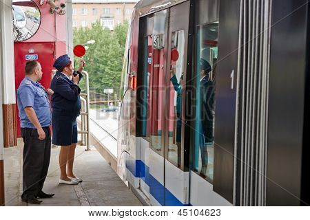 MOSCOW - MAY 14: Employee of Moscow monorail system at station Sergei Eisenstein  Street before departure of train, May 14, 2012, Moscow, Russia.