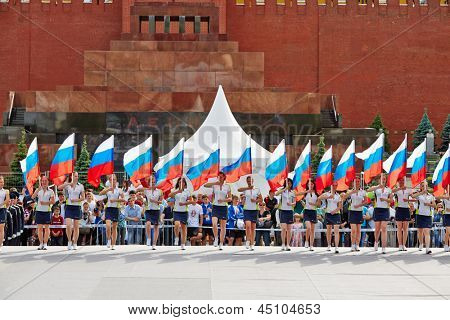 MOSCOW - MAY 27: Group of girls with flags of Russian Federation on Red Square during 8-th sports forum GTO, May 27, 2012, Moscow, Russia. More than 50 teams perform their sports program in forum.
