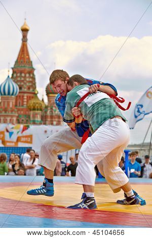 MOSCOW - MAY 27: Fight of participants of first All-Russian tournament on Russian traditional struggle For Collar during 8th sports forum GTO on Red Square, May 27, 2012, Moscow, Russia.