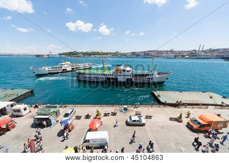 ISTANBUL - JUL 2: Two ships on the river coming to pier on July 2, 2012 in Istanbul, Turkey.