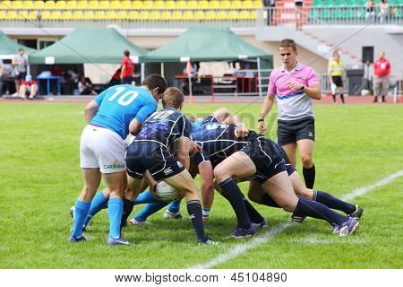 MOSCOW - JUNE 30: Athletes from Italy (in Blue) and Scotland (in black) take part in second stage of European championship on rugby-7 in sports complex Luzhniki, on June 30, 2012 in Moscow, Russia.