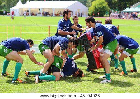 MOSCOW - JUNE 30: Rugby players from Portugal train on second stage of European championship on rugby-7 in sports complex Luzhniki, on June 30, 2012 in Moscow, Russia.