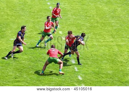 MOSCOW - JUN 30: Rugby players on second stage of European championship on rugby-7 in sports complex Luzhniki, Jun 30, 2012, Moscow, Russia. Players in red from Portugal, from Scotland in blue.
