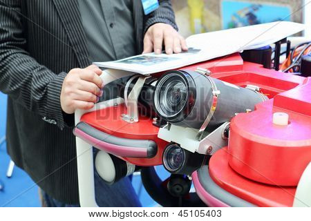 MOSCOW - MAY 23: Demonstration of devices for underwater photography at Russia Marine Industry Conference 2012 in Gostiny Dvor, on May 23, 2012 in Moscow, Russia.