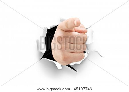 A view of a male hand pointing through a hole in paper isolated on white background