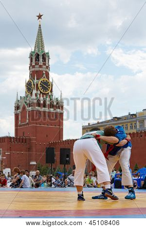 MOSCOW - MAY 27: Fight between participants of first All-Russian tournament on Russian traditional struggle For Collar during 8th sports forum GTO on Red Square, May 27, 2012, Moscow, Russia.