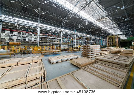 Packing sheets of aluminum in the manufacturing shop floor.