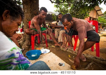 BERDUT, MALAYSIA - APR 8: Unidentified people Orang Asli during play cards on Apr 8, 2013 in Berdut, Malaysia. More 76% of all Orang Asli live below the poverty line, life expectancy - 53 years old.