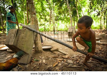 BERDUT, MALAYSIA - APR 8: Unidentified child Orang Asli in his village on Apr 8, 2013 in Berdut, Malaysia. More than 76% of all Orang Asli live below the poverty line, life expectancy - 53 years old.