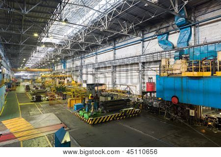 Line with press machine of rolling mill in in the manufacturing shop floor plant