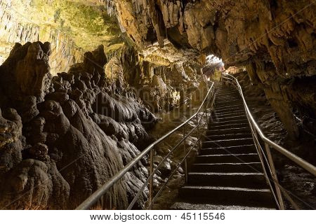 A long staircase leading to the entrance of the cave