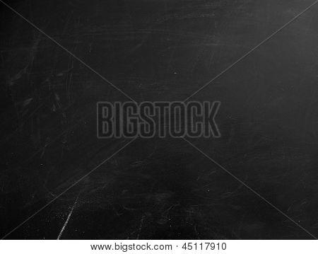 Blackboard texture. Empty blank black chalkboard with chalk traces