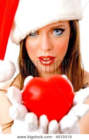 Close View Of Christmas Female Holding Heart