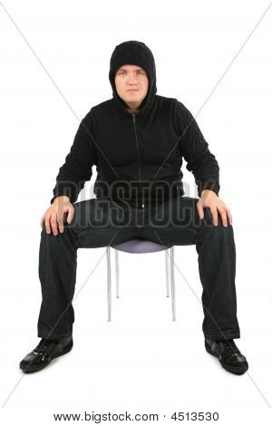 Man Is Strained Sits On A Chair.