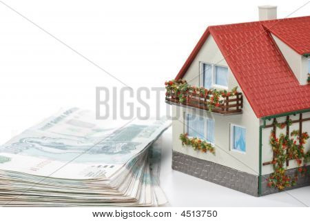 Miniature House And Money.