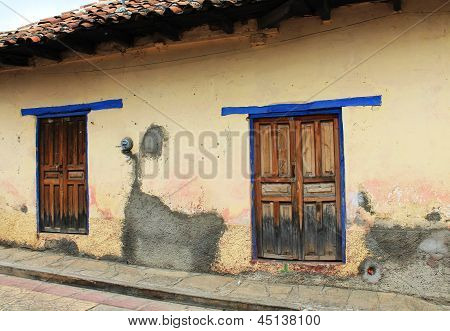 Wooden Doors In A Weathered Wall In Colonial Mexico