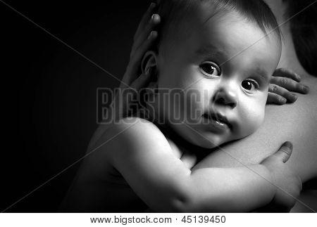 Cute Baby At Hands Of The Mother In An Embrace, Monochrome