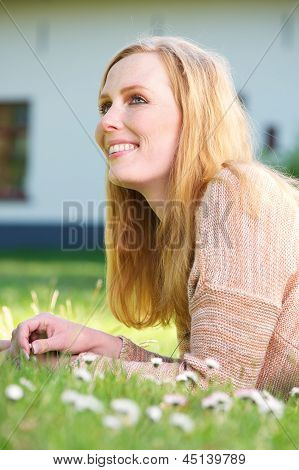 Beautiful Young Woman Smiling And Relaxing Outdoors