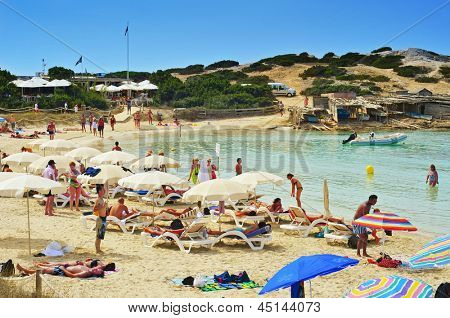 FORMENTERA, SPAIN - SEPTEMBER 18: Bathers in Ses Illetes Beach on September 18, 2012 in Formentera, Balearic Islands, Spain. Formentera is renowned across Europe for many white beaches like this