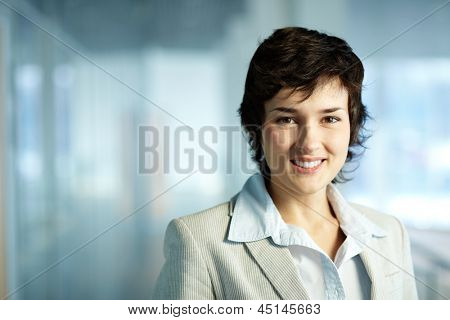 Image of formal businesswoman looking at camera