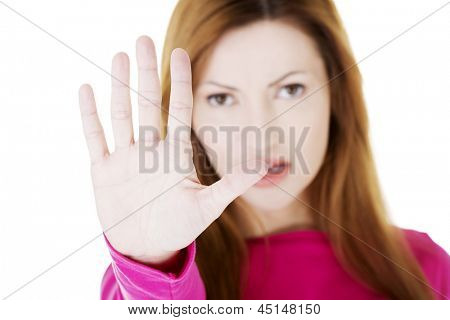 Hold on, Stop gesture showed by adult woman hand