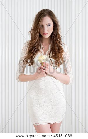 Fashion Portrait Of A Young Sexy Woman Wearing A White Dress