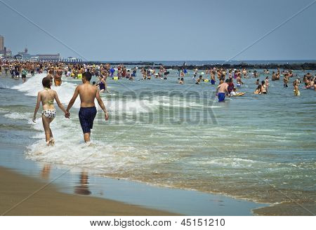 Couple Along The Beach