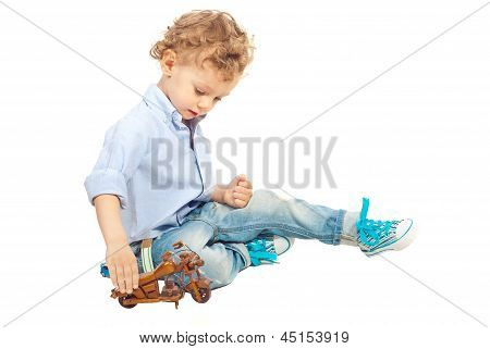 Kid Boy Playing With Wooden Bike
