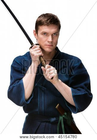 Kendo fighter in hakama training with bokken, isolated on white background. Japanese martial art of sword fighting