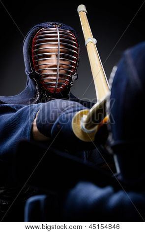 Close up of competition of two kendo fighters. Japanese martial art of sword fighting
