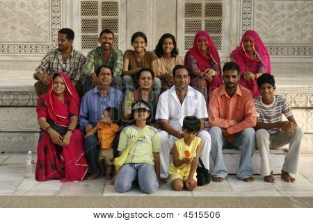 Joyful Indian Family Posing By Taj Mahal.