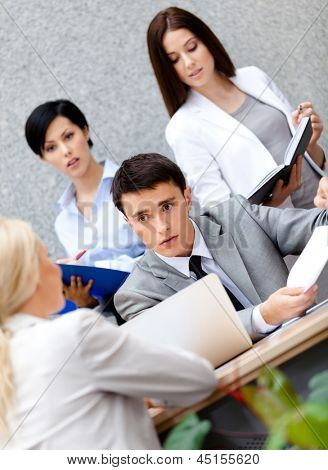 Businessman at the presentation with his employees discussing something important