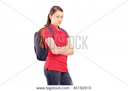 A sad female teenager with a backpack, isolated on white background