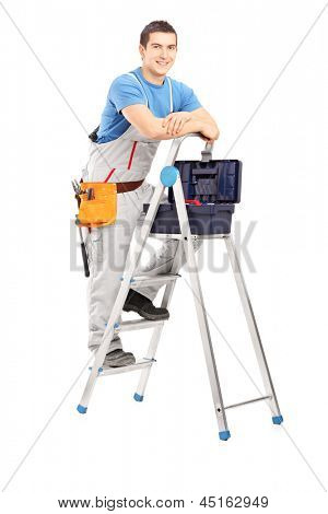Full length portrait of a handy man posing on a ladder, isolated on white background