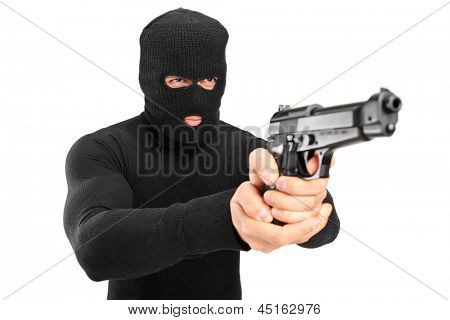 A thief with robbery mask holding a gun isolated against white background