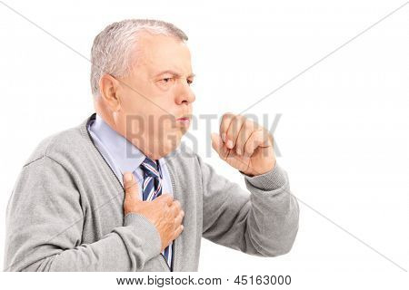 A mature gentleman coughing because of pulmonary disease isolated on white background