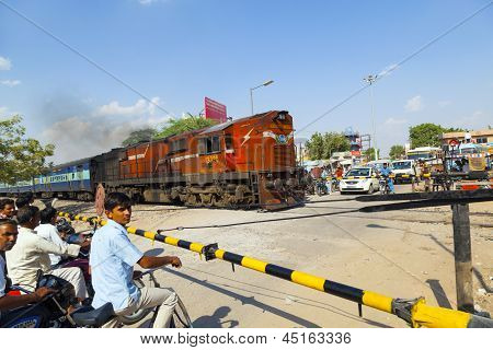 Indian Railway Train Passes A Railroad Crossing