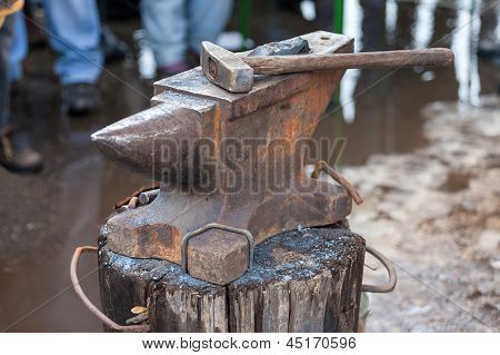 Old Anvil With Blacksmith Tools On The Outdoors