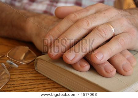 Old hands on a book