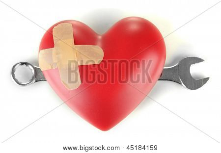 Heart and tools. Concept: Renovation of heart. Isolated on white