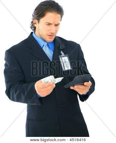 Confused Businessman Holding Money And Calculator
